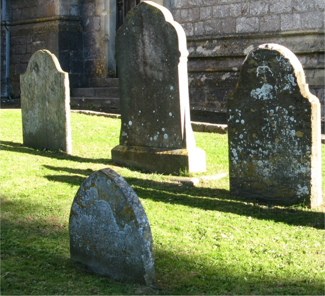 Four gravestones in churchyard