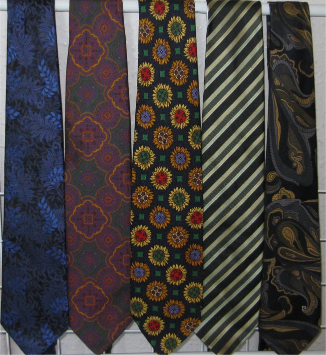 5 assorted ties hanging from rail