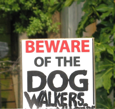 Beware of Dog sign with 'Walkers' added