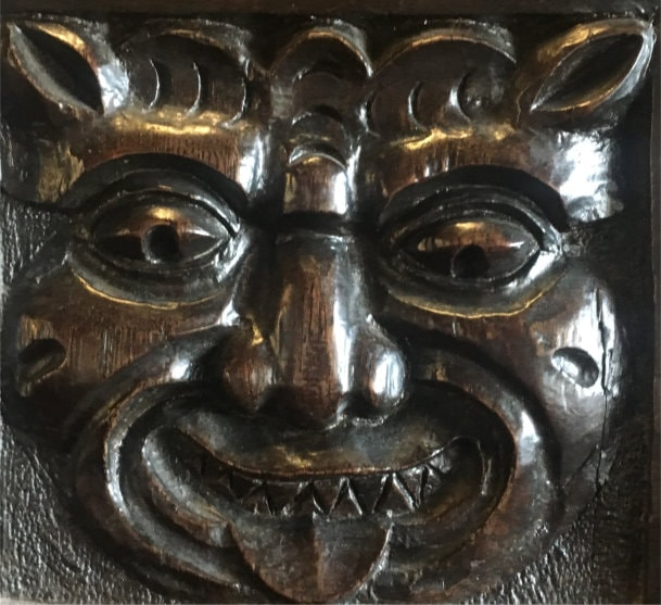 Carved grinning face